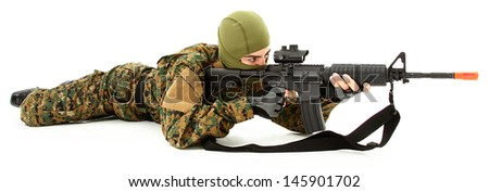 Young Man in Camo Shooting Air Rifle - stock photo