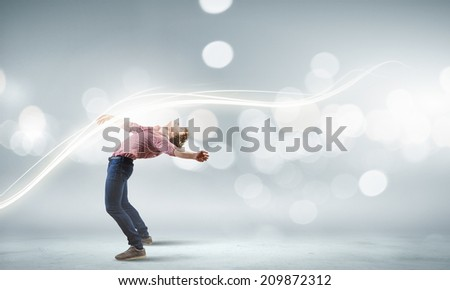 Young man in casual acting - stock photo