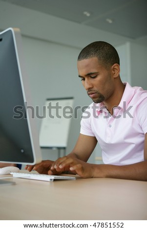 Young man in computer lab - stock photo