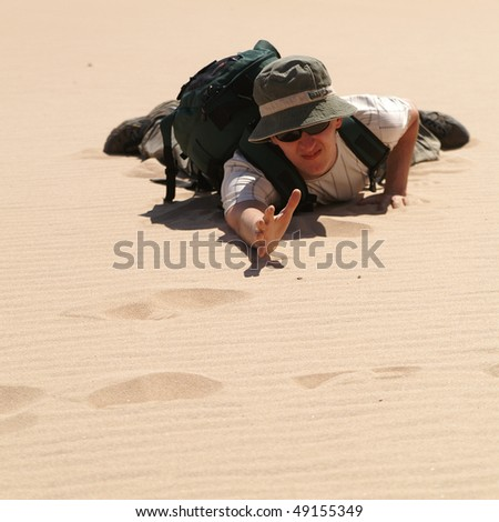 young man in desert, sand - stock photo