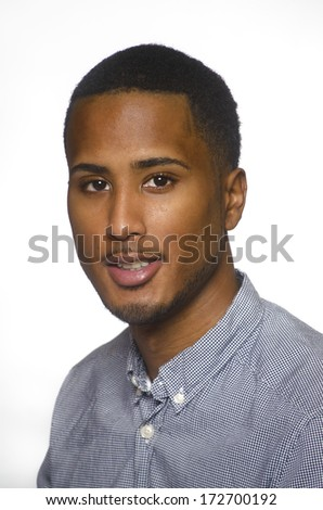 Young man in dress shirt isolated against white