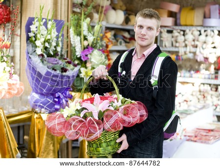 Young man in flower shop