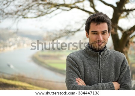young man in front of Rhine river, Germany
