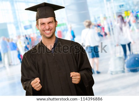 Young Man In Graduation Gown, Indoor - stock photo