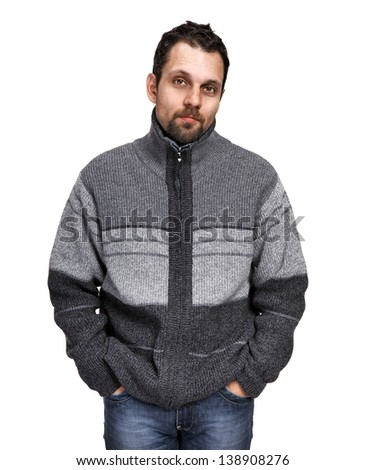 young man in grey sweater with hands in pockets looking into camera isolated on white background  - stock photo