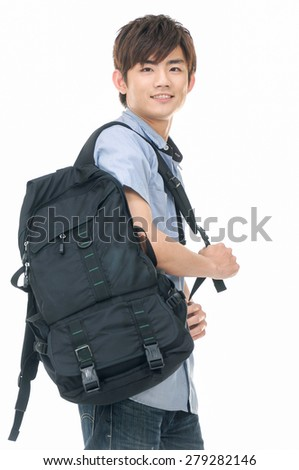 Young man in jeans standing with bag on white background - stock photo