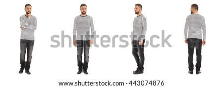 Young man in jeans with tattoos against white background looking tough