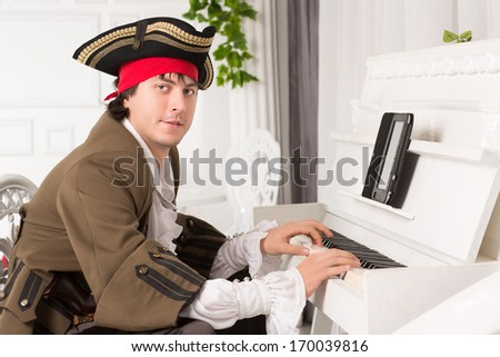 Young man in medieval costume playing the piano