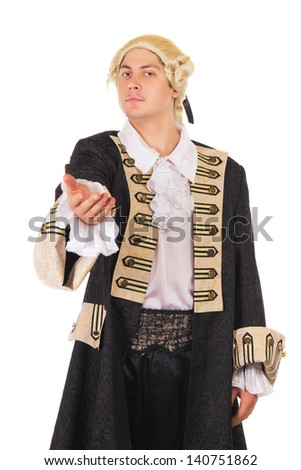 Young man in medieval costume standing with an outstretched hand. Isolated on white