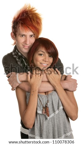 Young man in orange hair hugging girlfriend