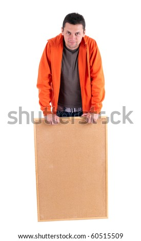 young man in orange sweatshirt keeping cork board - stock photo