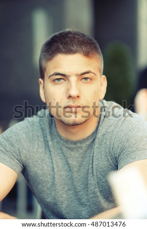 Young man in outdoor restaurant