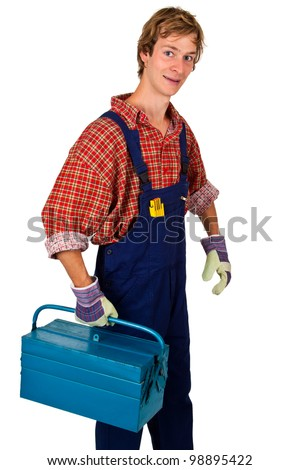 Young man in overalls carrying a toolbox