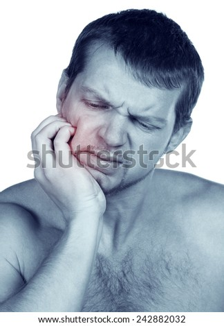 Young man in pain is having toothache isolated on white. Hang-over syndrome - stock photo