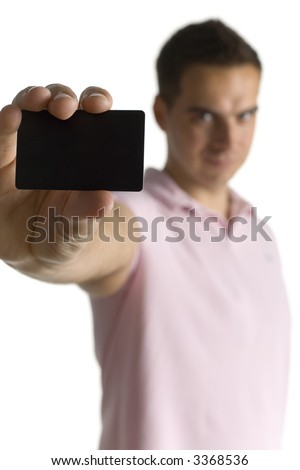 Young man in pink polo shirt, showing credit card. Isolated on white in studio. Closeup on credit card