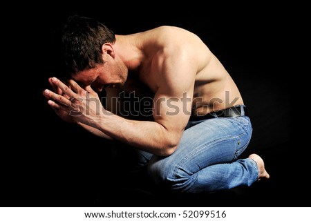 Young man in pose - stock photo
