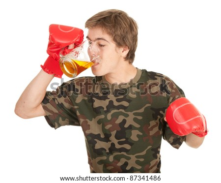 young man in red boxing gloves with beer, white background - stock photo