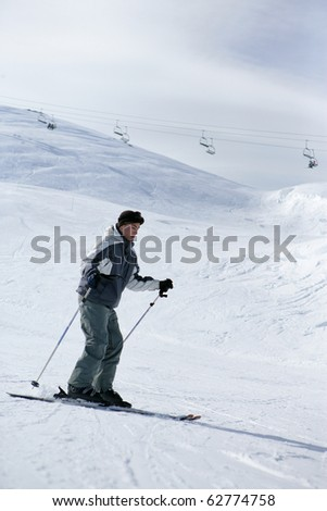 Young man in snow - stock photo