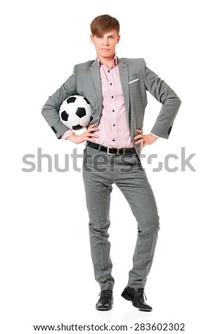 Young man in suit with soccer ball, isolated on white background - stock photo