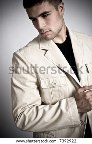 young man in suite, white background - stock photo