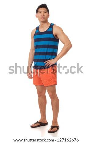 Young man in swimwear. Studio shot over white. - stock photo
