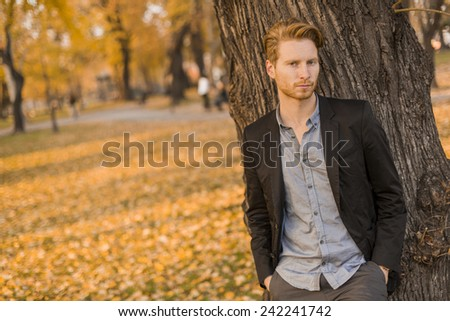 Young man in the autumn park