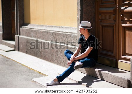 Young man in the city in casual clothes