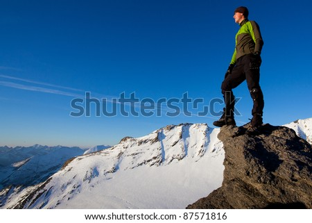 Young man in the mountains - stock photo