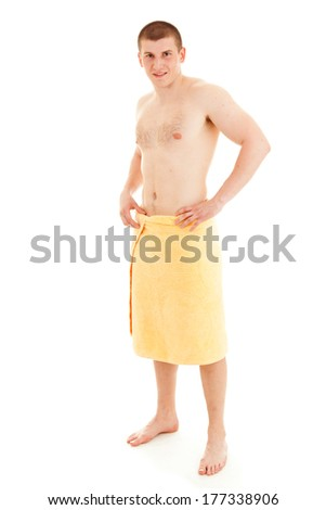 young man in towel, full lenght, white background - stock photo