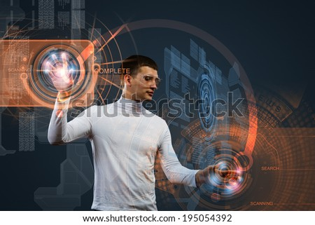 Young man in white touching icon of media screen - stock photo
