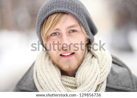 Young man in winter clothes - stock photo