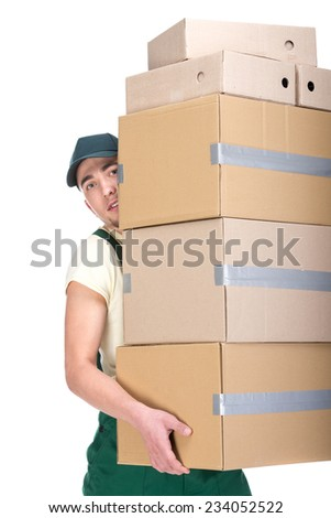 Young man is holding cardboard boxes on white background.