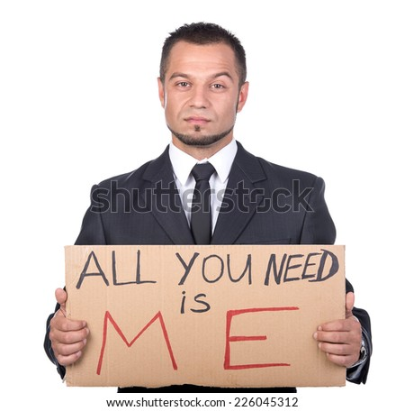 Young man is holding sign All you need is me. He is looking for a job. - stock photo