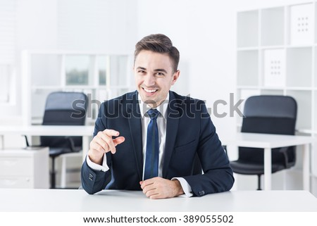 Young man is joking during his job interview  - stock photo