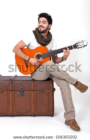 young man is playing a guitar and singing - stock photo