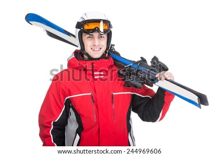 Young man is posing with skis in studio, isolated on white background. - stock photo