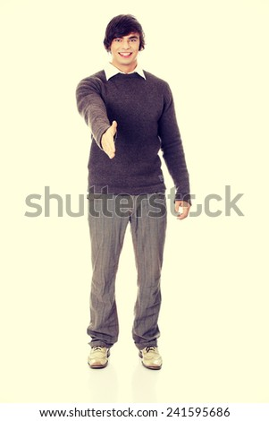 Young man is shaking hand. - stock photo