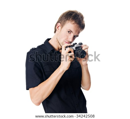 Young man isolated on white with camera