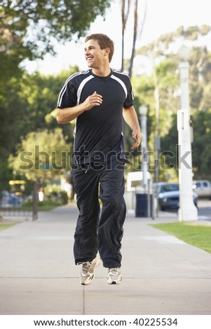 Young Man Jogging On Street