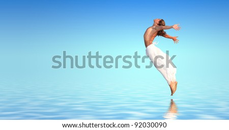 Young man jumping in the water