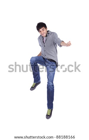 Young man jumping isolated on white (some motion blur) - stock photo