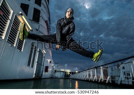 Young man jumping on the deck