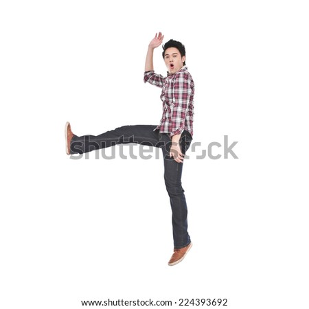 Young man jumping on white background - stock photo