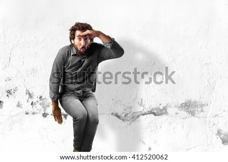 young man jumping. worried expression