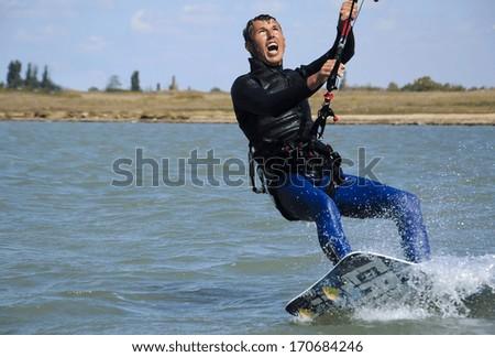 Young Man KiteBoarding, Extreme Sport Kitesurfing - stock photo