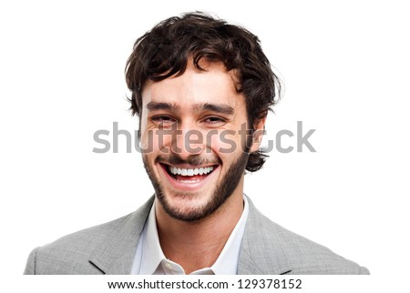 Young man laughing isolated on white - stock photo