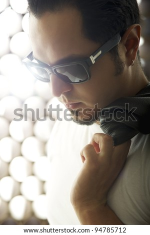 Young man leading a glamourous life. - stock photo