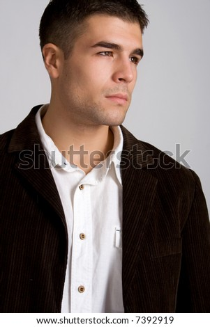 young man leaned on hand, studio shot - stock photo