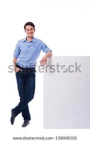 Young man leaning on the empty board  - stock photo