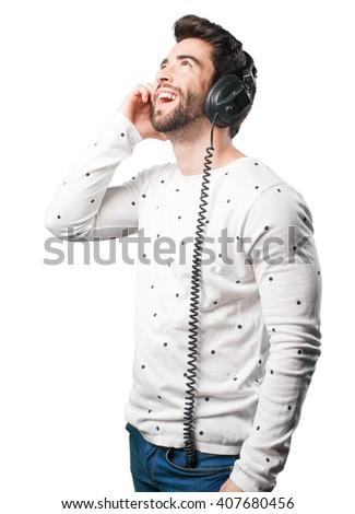 young man listening headphones - stock photo